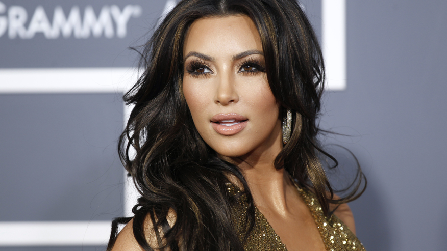 Television personality Kim Kardashian arrives at the 53rd annual Grammy Awards in Los Angeles