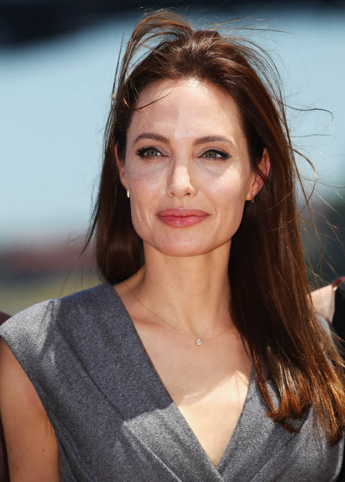 SYDNEY, AUSTRALIA - NOVEMBER 18:  Angelina Jolie poses at the photo call of Unbroken at Sydney Opera House on November 18, 2014 in Sydney, Australia.  (Photo by Don Arnold/WireImage)