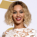 "FILE - This Jan. 26, 2014 file photo shows Beyonce at the 56th annual Grammy Awards in Los Angeles. The Department of Women's and Gender Studies at Rutgers University is offering a course called ""Politicizing Beyonce."" Kevin Allred, a doctoral student who is teaching the class, tells the university's online news site that he is using her career as a way to explore American race, gender and sexual politics. The class supplements an analysis of her videos and lyrics with readings from Black feminists. (Photo by Dan Steinberg/Invision/AP, FIle)"